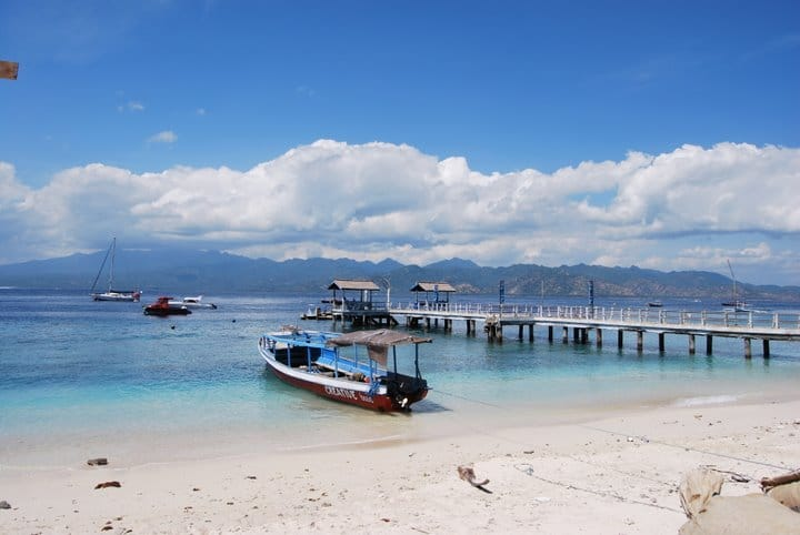 Dock and landing for arriving boats at Gili Trawangan with Lombok in the background.